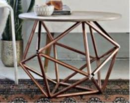 Table basse cuivrée -Source Designmag.fr
